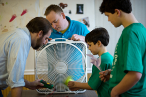 volunteers work with 4-Hers on wind power project; photo by Edwin Remsberg, USDA
