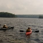 Two kayakers on Maine lake; photo by Edwin Remsberg