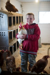 4-Her with poultry; photo by Edwin Remsberg