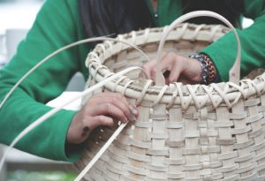 woman making an ash pack basket
