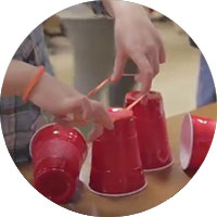 Youth experiments with plastic cups and rubber bands