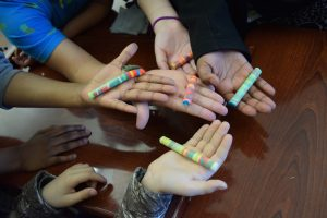 """Youth holding Playdoh """"core samples"""" after a science activity"""