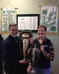 Ron Drum and Franklin County 4-H staff hold two loving cups.