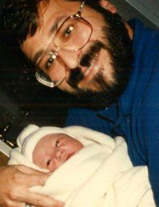 Ron Drum with newborn son Philip in 1995.