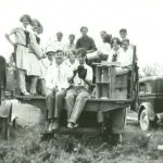 Group photo of the Lucky Lindy Club on the back of a truck