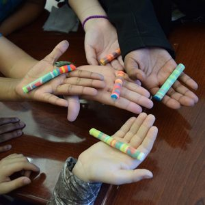 "Youth holding Playdoh ""core samples"" after a science activity"