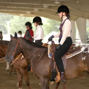 4-Hers and their horses compete at the fair