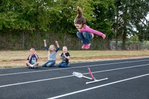 elementary school children using elements from a 4H rocket project kit
