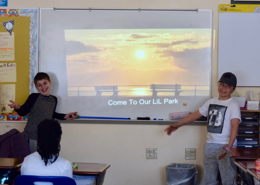 two boys standing on either side of presentation