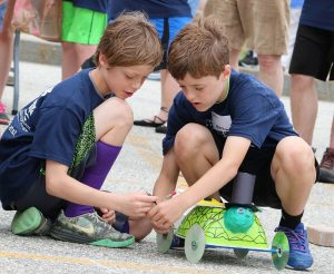 2 youth on the starting line with their solar car