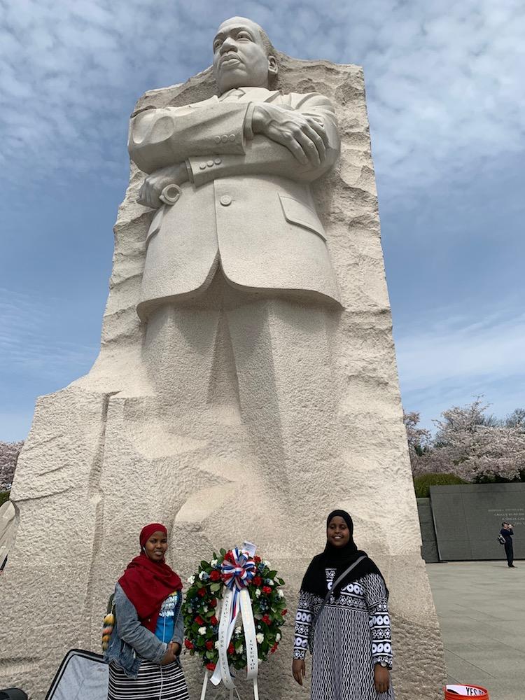 two teen girls standing beside memorial wreath at MLK Jr. Memorial