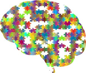 brain graphic that shows a jigsaw puzzle to depict thinking