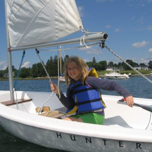 Camper learns to sail at 4-H Camp and Learning Center at Blueberry Cove