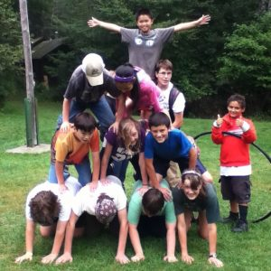 Campers form a pyramid at the 4-H Camp and Learning Center at Tanglewood
