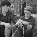 2 4-H'ers practice tying knots