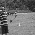 4-H'er practicing archery