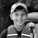4-H'er with canoe paddle and fishing pole