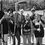 group of 4-H'ers on the dock with canoe paddles
