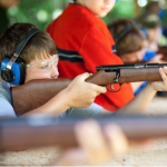 Youth shooting during gun safety.