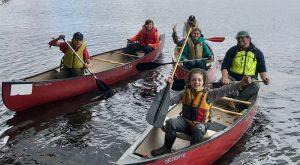 4-H'ers paddling canoes
