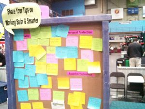 bulletin board covered with sticky notes