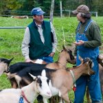 Richard Brozozowski talking with goat farmer