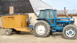 blue tractor and implement
