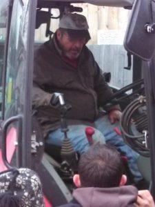 Farmer in tractor cab