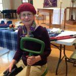 Ellen Gibson holding a shovel in a classroom