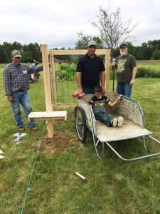 volunteers build a trellis-based vertical garden as part of a permanent display by Maine AgrAbility at the Common Ground fairgrounds