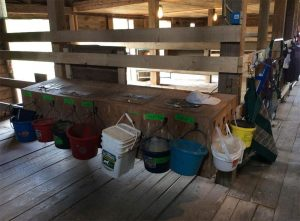 hanging buckets of various colors