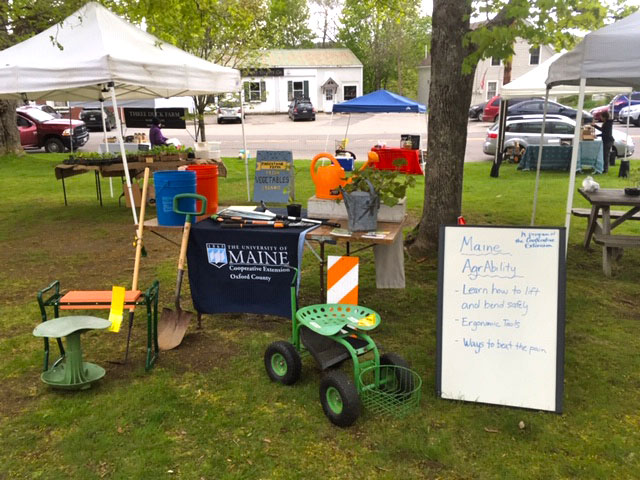 AgrAbility tent with info signs and adaptive equipment
