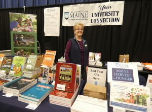 Tracey Ferwerda, Publications Manager/Graphic Designer, at the UMaine Extension booth at the 2020 Maine Agricultural Trades Show