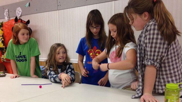 five club members doing a STEM project