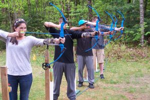 campers practice their archery skills