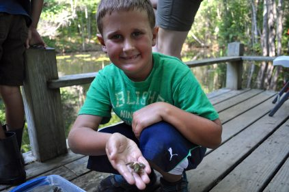 camper with frog