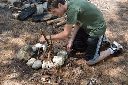 camper builds a fire