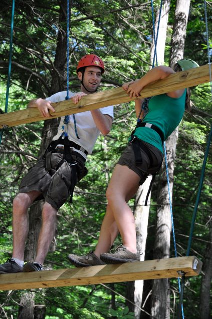 1 youth and 1 adult on a high ropes element