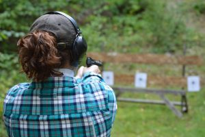 camper practices target shooting