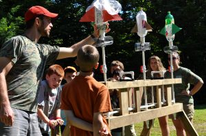 instructor helps campers build rockets