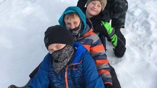 group of youth sledding