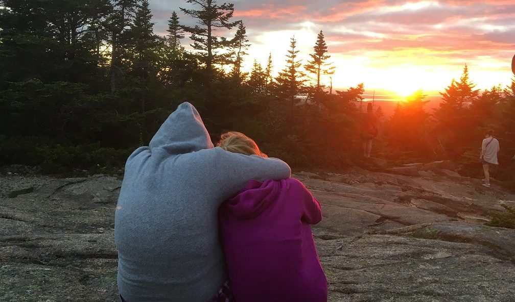 campers looking at sunset