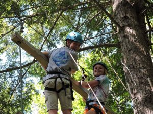 Two campers on a high ropes element