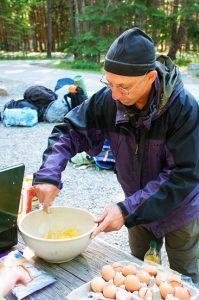 adult volunteer scrambling eggs