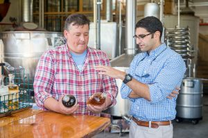 producer of spirits in distillary with Extension food safety expert