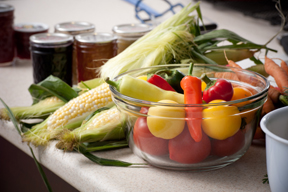 peppers, tomatoes, corn on the cob, and canning jars
