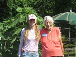 Garden Angel volunteer with a program participant, 2016