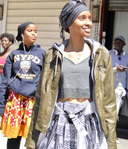 Nasteho and Nimo model the clothing they bought at the African Market in Harlem.
