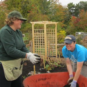 Garden class participants add soil to a garden bed at Tidewater Farm