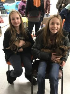2 girls with 2 baby goats